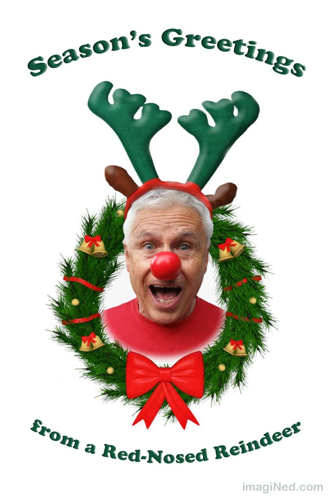 "Photo of Ned Buratovich in a red shirt, red clown nose, green reindeer antlers and a ""Wow!"" expression poking through an evergreen bough Christmas wreath with a big red bow at the bottom."