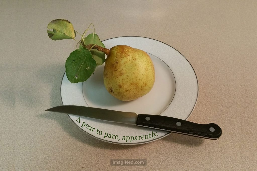 On a counter-top sits a small white desert plate containing a freshly picked pear (three leaves still attached to the stem) with a small knife beside it. Curving along the edge of the plate is this text: A pear to pare, apparently