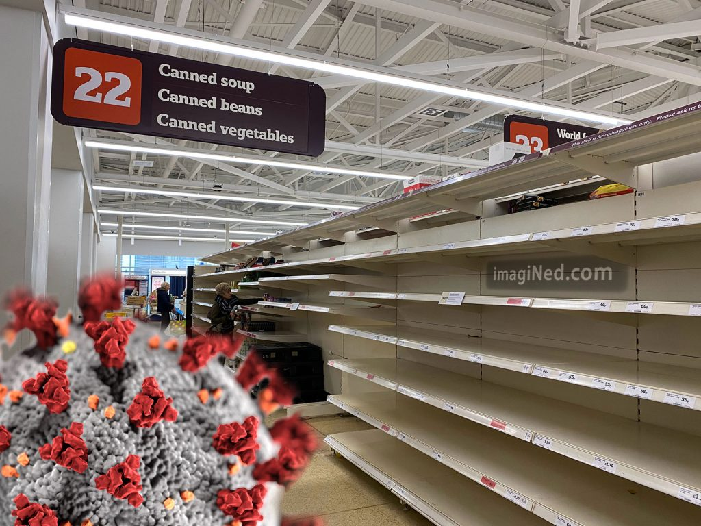 An electron microscope image of the spiky coronavirus covers the bottom-left corner of a photograph of completely empty supermarket shelves, eight feet tall, going back fifty feet in distance.