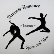 "Imagine a circle: at eleven o'clock the phrase, ""Dance is Romance,"" arcs across the top. At eight o'clock and two o'clock are two silhouettes. At eight o'clock stands a long-haired woman in a wide-stance back bend, arms extended gracefully above and behind. From the two o'clock position leaps a lithe male dancer, airborne in a bent-leg ballet jete, arms also extended, in front and behind . Between the two silhouettes stretches the word, ~ between ~. The words, ""Space and Time,"" bend beneath like a chair-rocker at five of the clock to complete the circuit."
