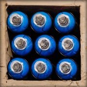 Case pf blue spray-paint cans