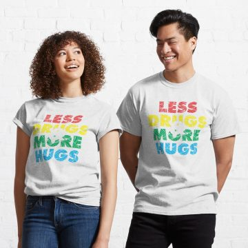 """photo of a man and woman, each wearing a """"Less Drugs, More Hugs"""" T-shirt"""