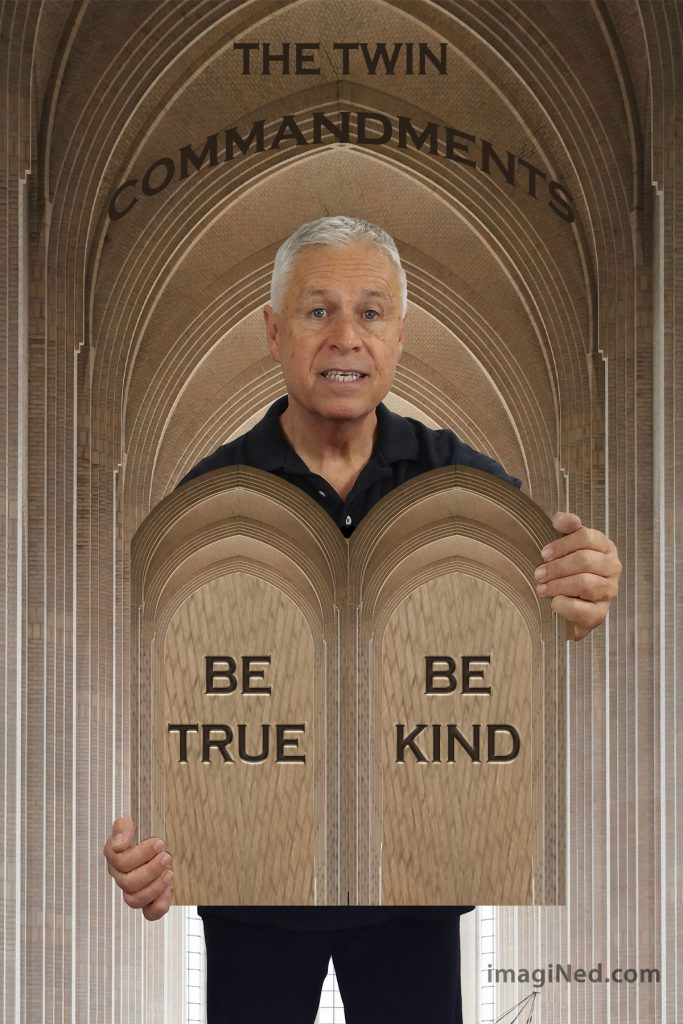 Ned Buratovich stands in the nave of a church with its soaring vaulted ceilings reflected in the shape of the twin tablets he holds, inscribed with the words: BE TRUE - BE KIND.