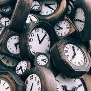 a pile of antique clocks