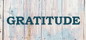Word GRATITUDE painted on a door