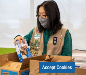 Girl Scout packing cookie boxes
