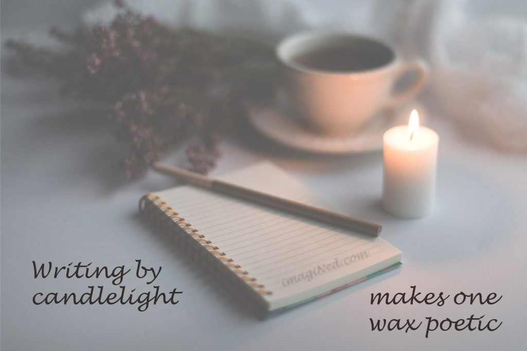 A gauzy photo in dim light shows a lit candle, notebook and pen, dried flowers and a cup of coffee on a tabletop, upon which is written: Writing by candlelight makes one wax poetic.