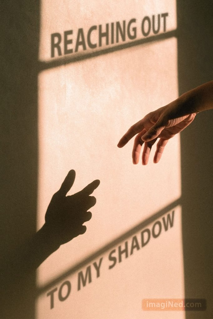 An extended hand almost touches its shadow on a sun-drenched wall.